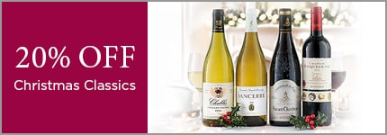 20% OFF Christmas Classics. Four wines from the christmas classics offering, accompanied by holly sprigs and glasses of wine.